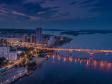 """Взгляд с высоты на Саратов и Волгу . Мост через Волгу на закате, ЖК """"Volga Sky""""."""
