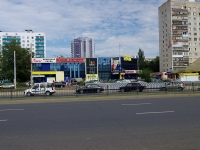 "neighbour house: avenue. Vakhitov, house 16А. shopping center ""Элекам"""