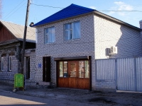 Astrakhan, Naberezhnaya pervogo maya st, house 80. Apartment house with a store on the ground-floor