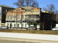 Astrakhan, Naberezhnaya pervogo maya st, house 97. Apartment house with a store on the ground-floor