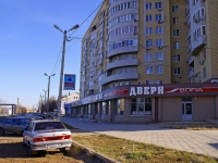 Astrakhan, Dzhon Rid sq, house 7 к.1. Apartment house with a store on the ground-floor