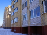 Astrakhan, Menzhinsky st, house 4 к.1. Apartment house