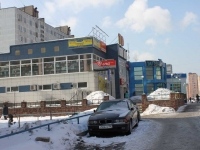 neighbour house: st. Lesnaya, house 18. shopping center РЕГИОН