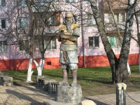 "neighbour house: st. Kommunisticheskaya. sculpture ""Богатырь"""