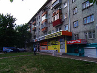 Samara, Revolyutsionnaya st, house 87. Apartment house with a store on the ground-floor