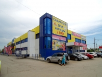 "neighbour house: st. Novo-Sadovaya, house 387. shopping center ""Поляна"""