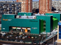 "neighbour house: st. 70 let Oktyabrya, house 56. shopping center ""Миндаль"""
