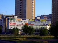 "neighbour house: st. Avtosrtoiteley, house 2. shopping center ""Кольцо"""